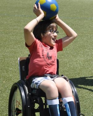 Photo of Nico playing soccer at Cotting School