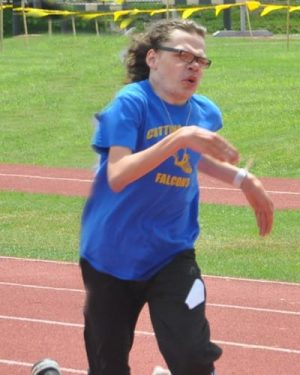 photo of Thoms running on the track