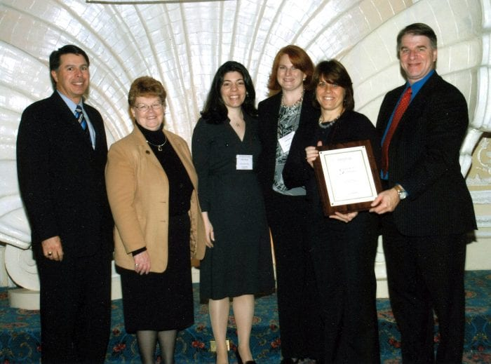 Cotting School Representatives holding their award accreditated by the New England Association of Schools and Colleges (NEASC) on December 3, 2009.