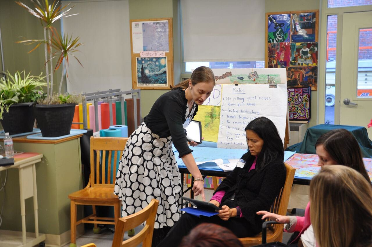 a Cotting School educator offers help to a parent in her Conference workshop presentation