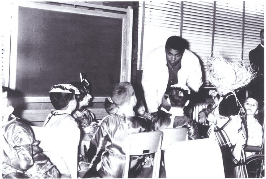 Muhammad Ali visiting a Cotting classroom in 1964