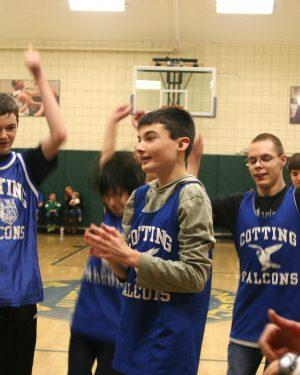 Patrick celebrates with his teammates Cotting basketball team