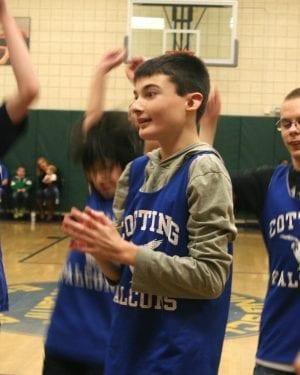 Patrick celebrates with his teammates Cotting basketball team
