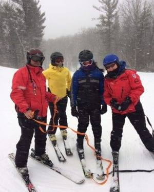 Cotting Student Nikita and her Ski Instructors in the snow on the ski slopes
