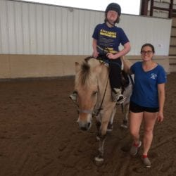 Elizabeth riding a horse